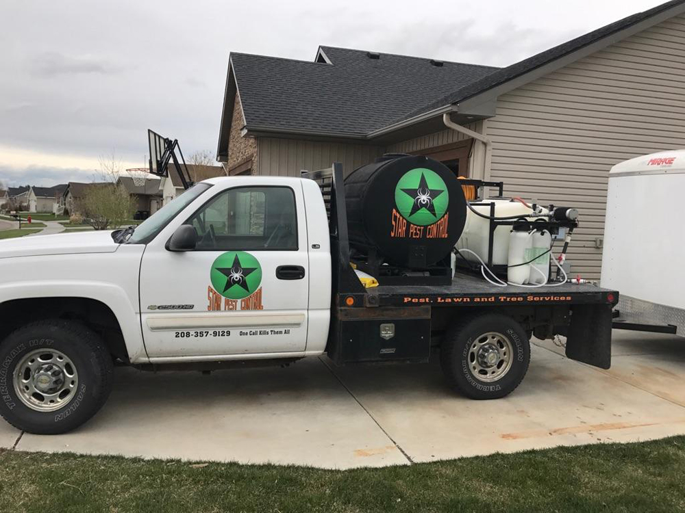 pest control truck with equipment outside of home